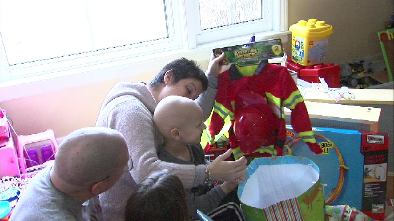 Christmas came early for a 5-year-old boy fighting cancer and the presents were delivered on a fire truck, instead of a sleigh.
