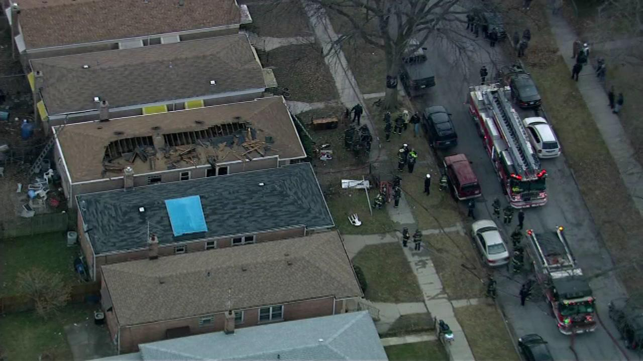 Several firefighters were freed after they became trapped in a basement while responding to a house fire on the citys Far South Side, officials said.