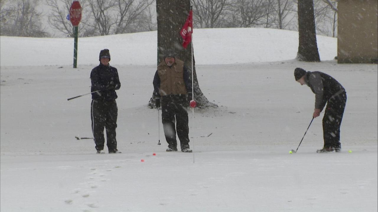 Snow could not keep some die-hard golfers off the course Sunday.