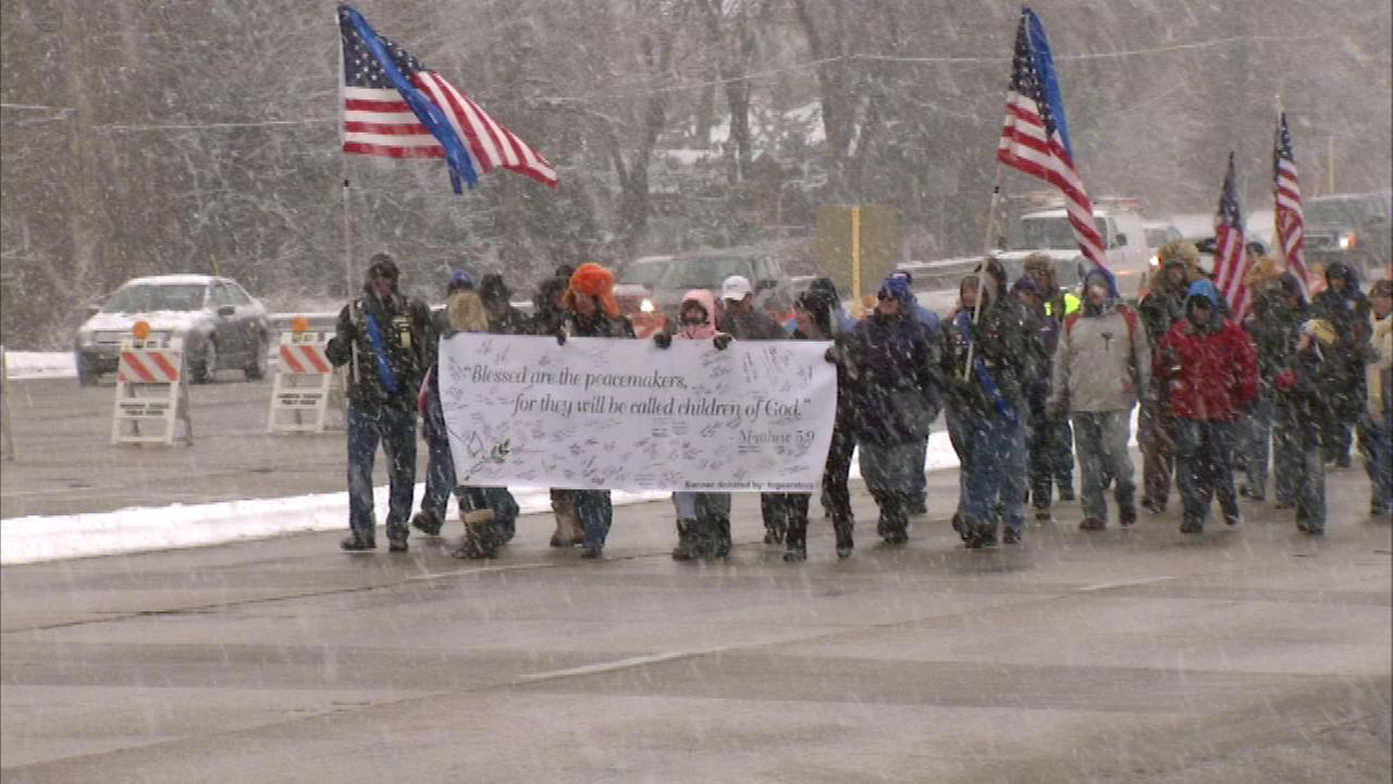 About 100 people took part in the Blue Ribbon Walk in suburban Oak Brook Sunday in another show of support for local police officers.