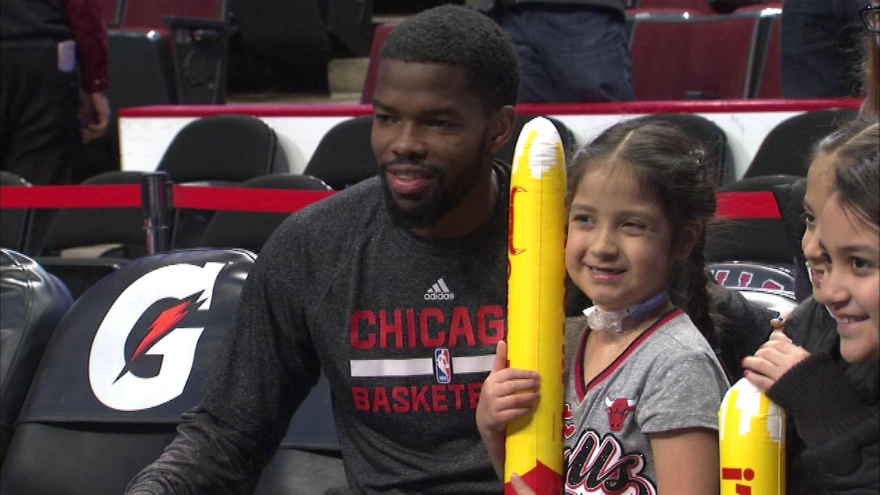 Bulls guard Aaron Brooks poses with 6-year-old Elena Perez before Monday nights game at the United Center.