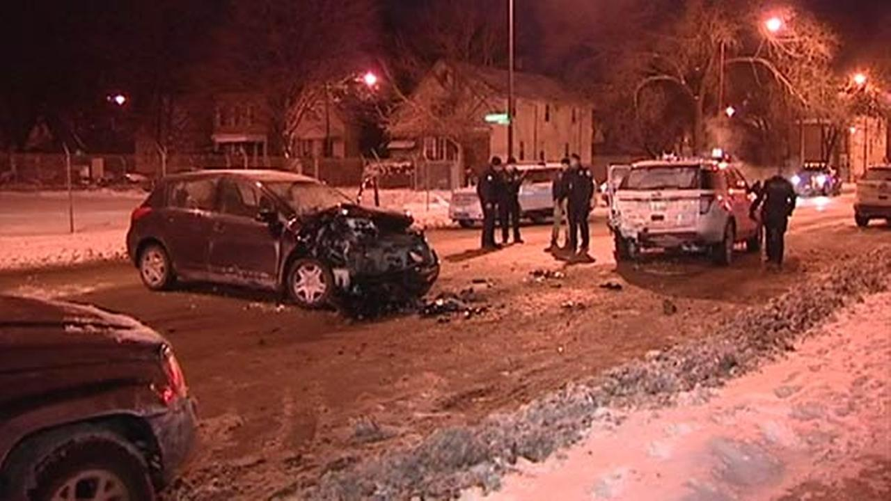 Officer injured after car hits two squad cars, police say