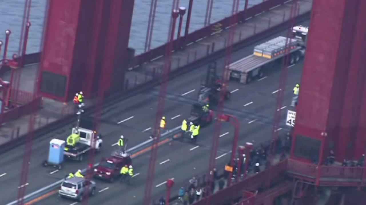 Yellow-clad work crews shared San Franciscos iconic Golden Gate Bridge with only bikers, runners, and seabirds Saturday.
