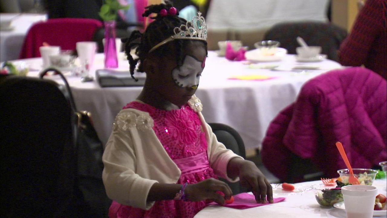 Dozens of inner city children were treated to a tea party and healthy lunch Saturday afternoon at the Sankofa Cultural Arts Center in the Austin neighborhood.