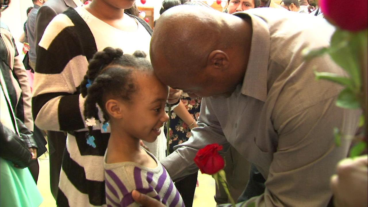 Dozens of Chicago fathers and daughters take part in an annual pre-Valentines Day event Saturday.