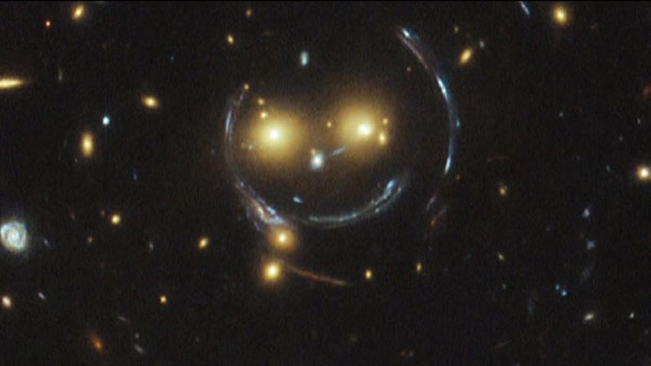 Smiley face galaxy cluster captured by Hubble telescope