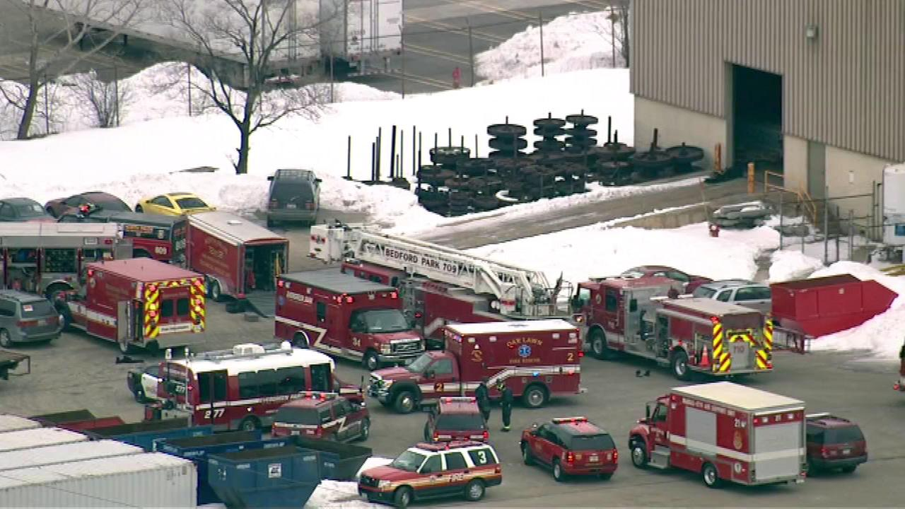 Worker trapped under heavy equipment at Bedford Park plant