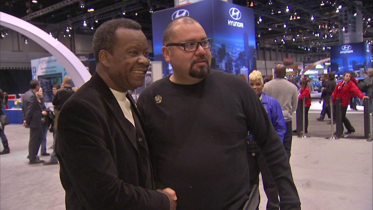 Chicago mayor candidate Willie Wilson greeted voters at the Chicago Auto Show on Saturday.