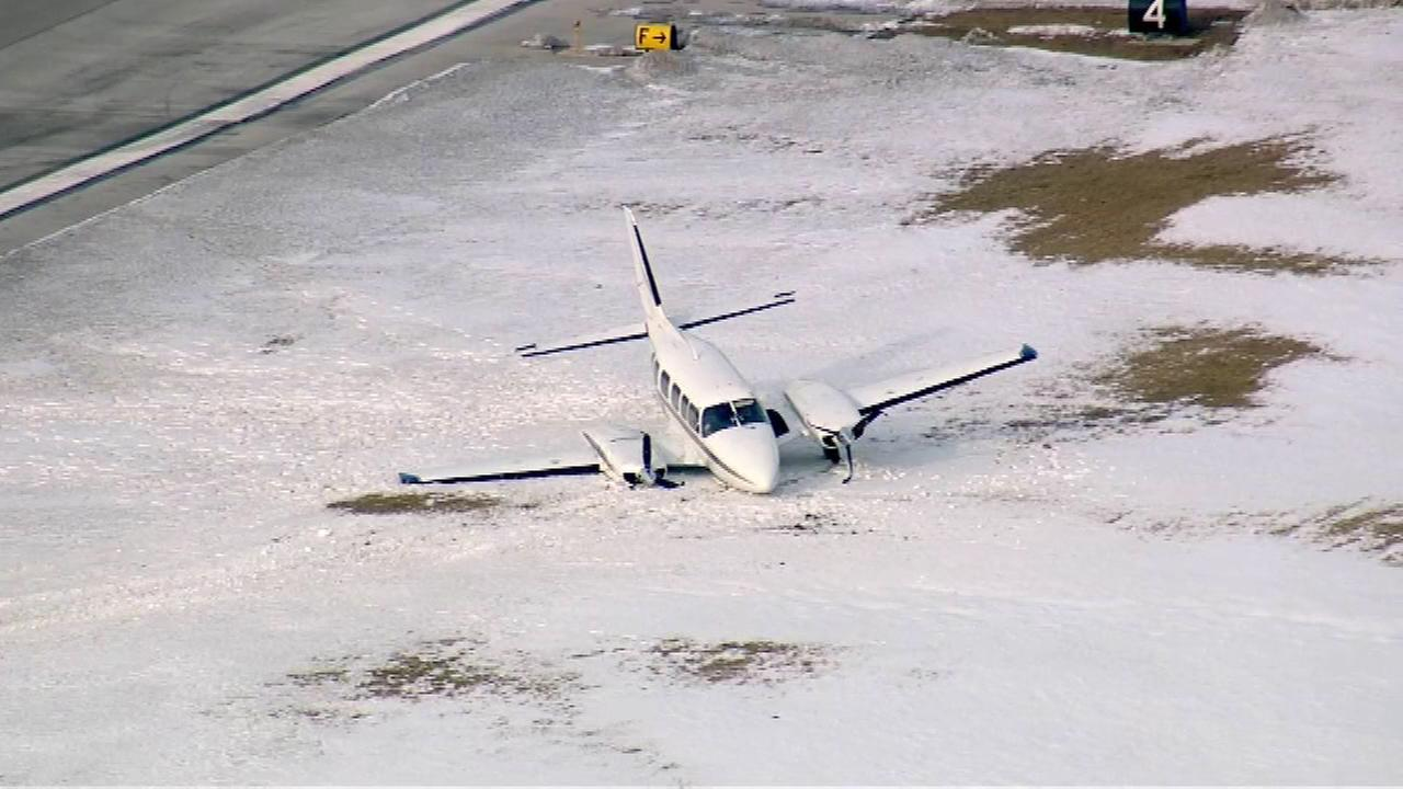 Twin engine plane runs off runway at Midway