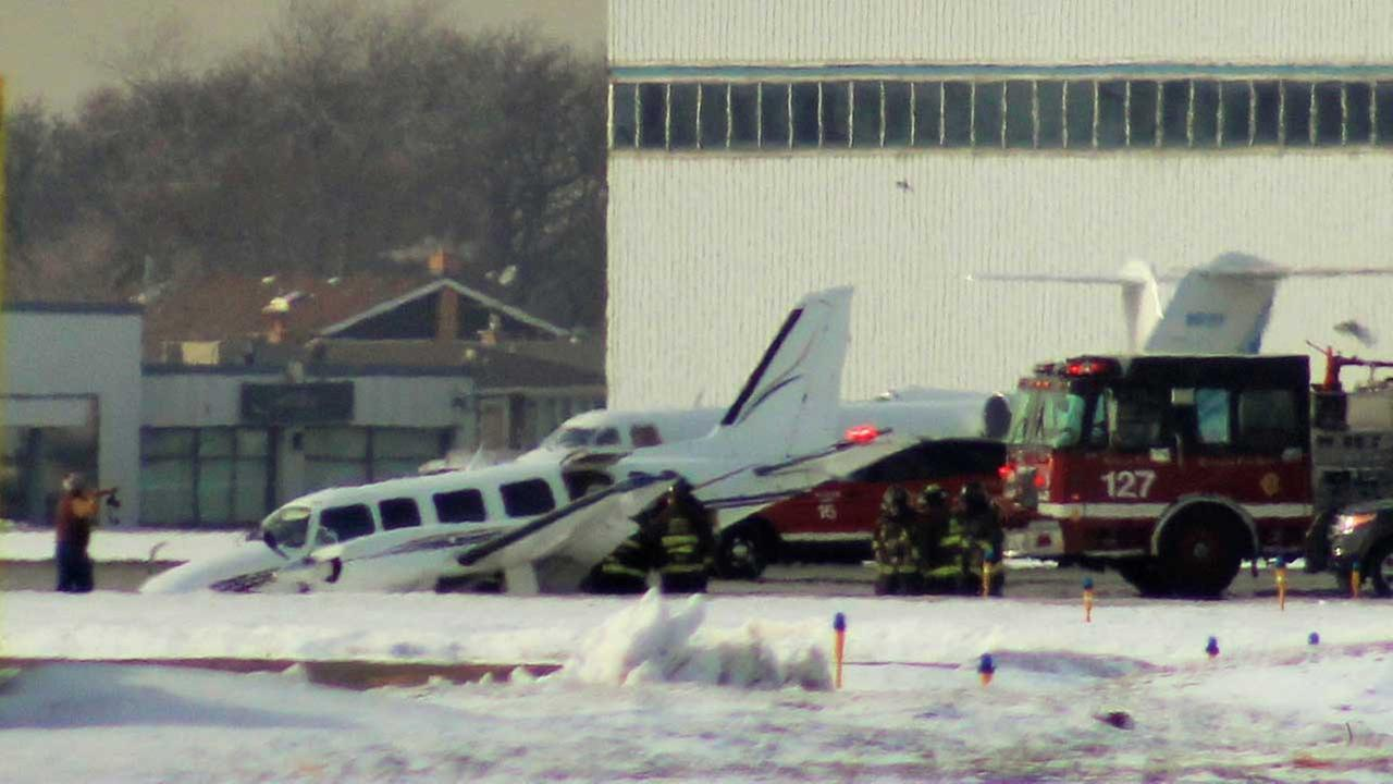 Small plane runs off runway at Midway on February 16, 2015.
