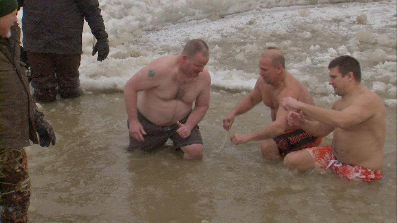 Law enforcement officials jumped into Lake Michigan at the annual Law Enforcement Torch Run Super Plunge to benefit Special Olympics.