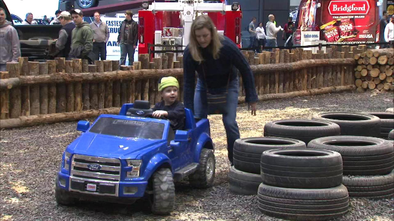 Children got some hands-on experience with some mini SUVs made just for them at the Chicago Auto Show Saturday.