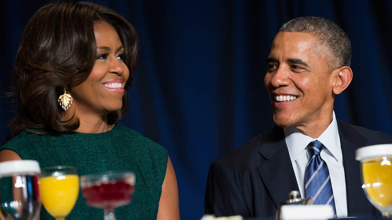 President Barack Obama and first lady Michelle Obama share a laugh during the National Prayer Breakfast in Washington on Feb. 5, 2015.