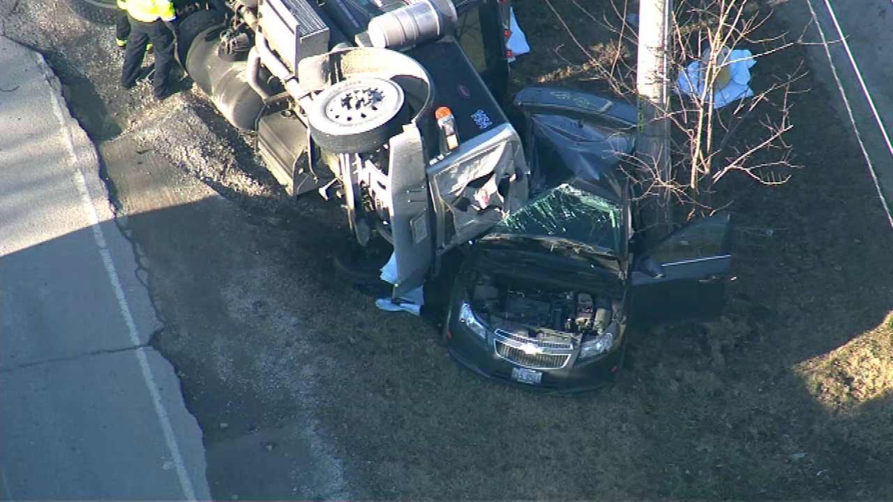 2 injured after semi rolls onto car in Woodridge