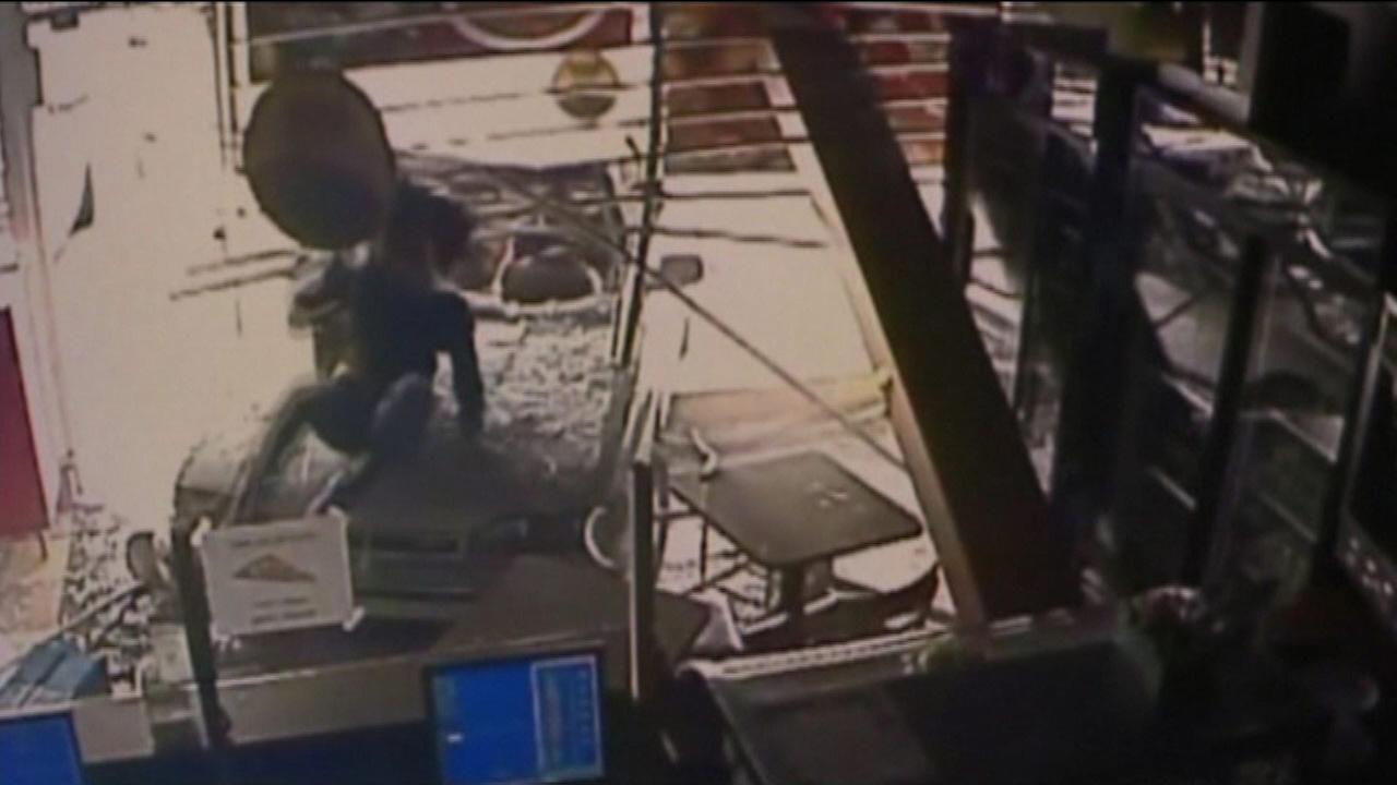 Car plows into restaurant, woman jumps off hood after being hit
