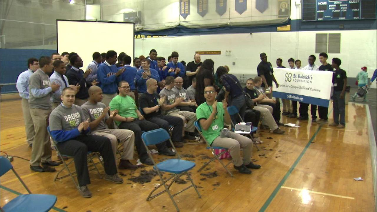 More than 50 students and faculty from De La Salle Institute are took part in a St. Baldricks head-shaving ceremony.