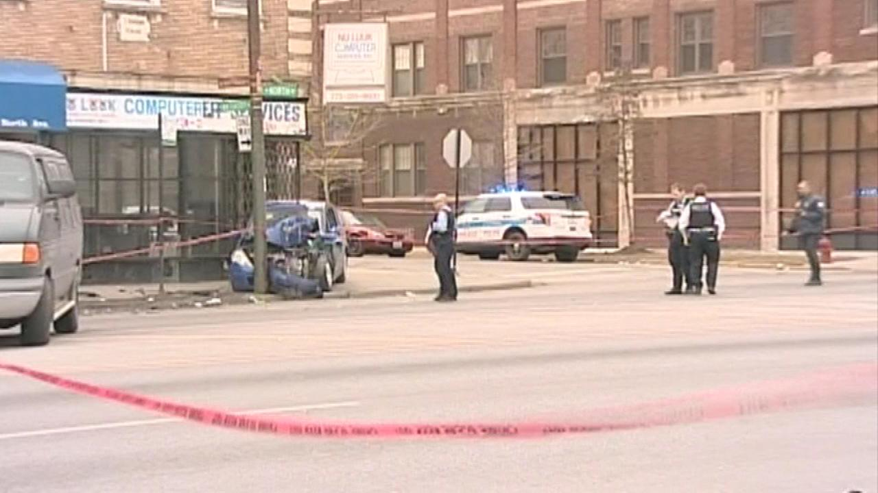 Two men were killed in a shooting in the citys Austin neighborhood Sunday afternoon and Chicago Police are searching for the gunman.