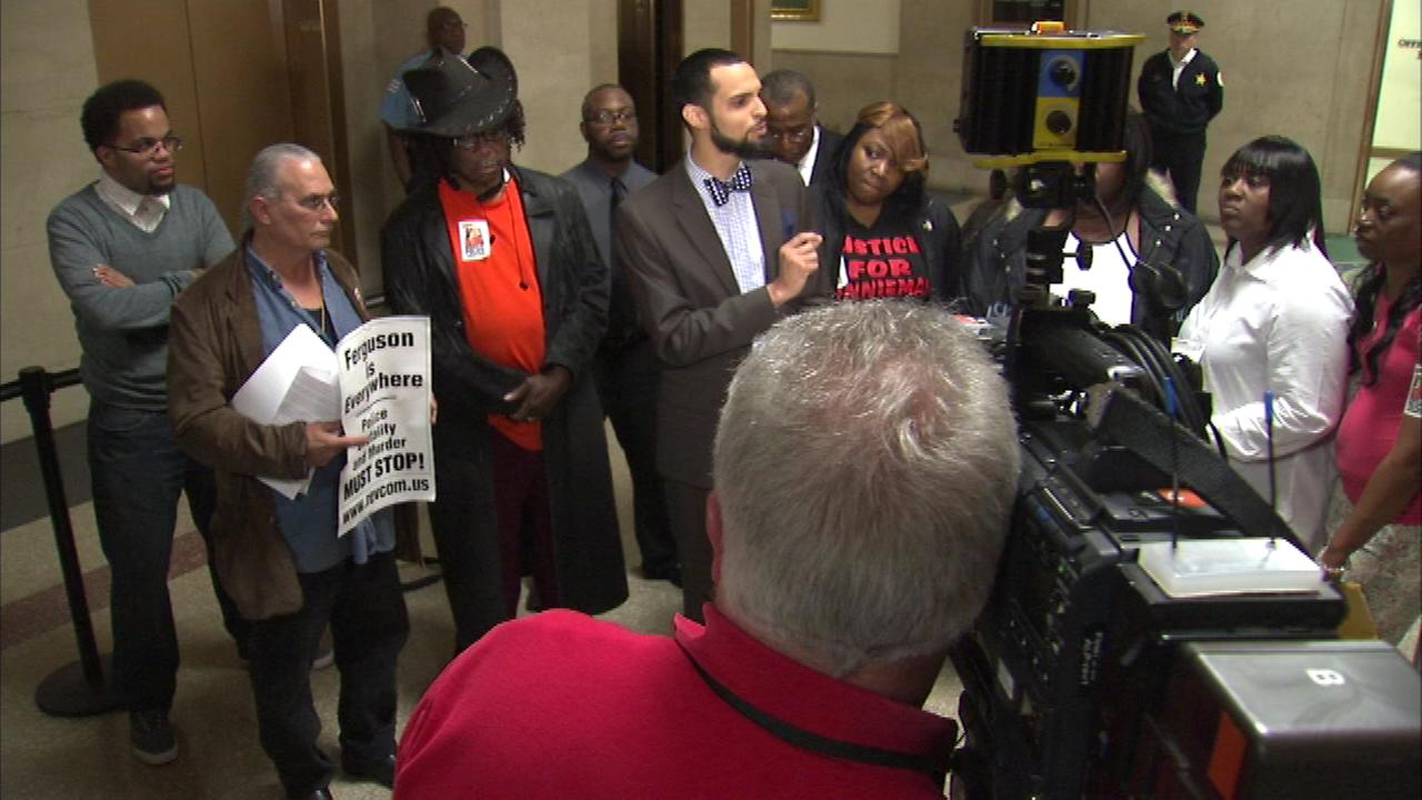 Families protest at City Hall after meeting with officials