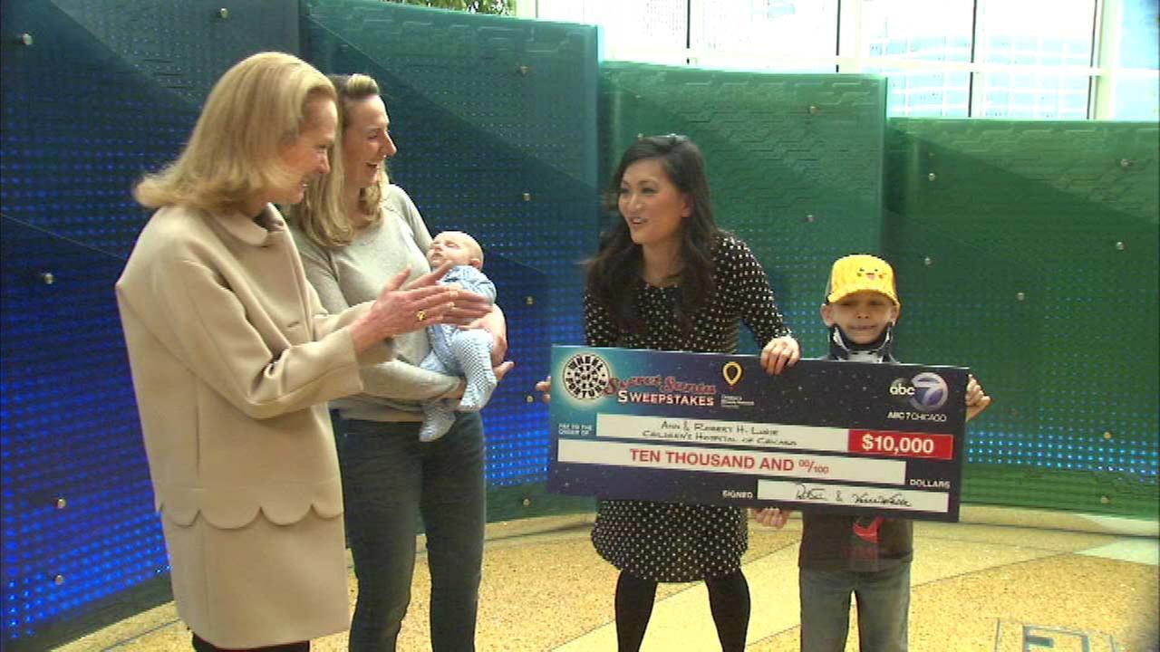 Windy City Live's Ji Suk Yi presents 'Wheel of Fortune' Secret Santa check to Lurie Children's Hospital