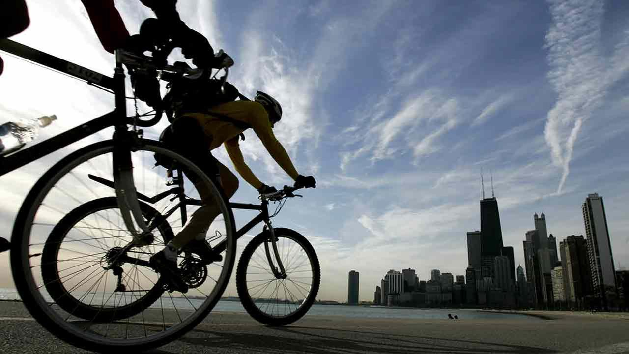 Two cyclists pedal along Lake Michigan in Chicago, during the early morning hours of Tuesday, April 11, 2006.