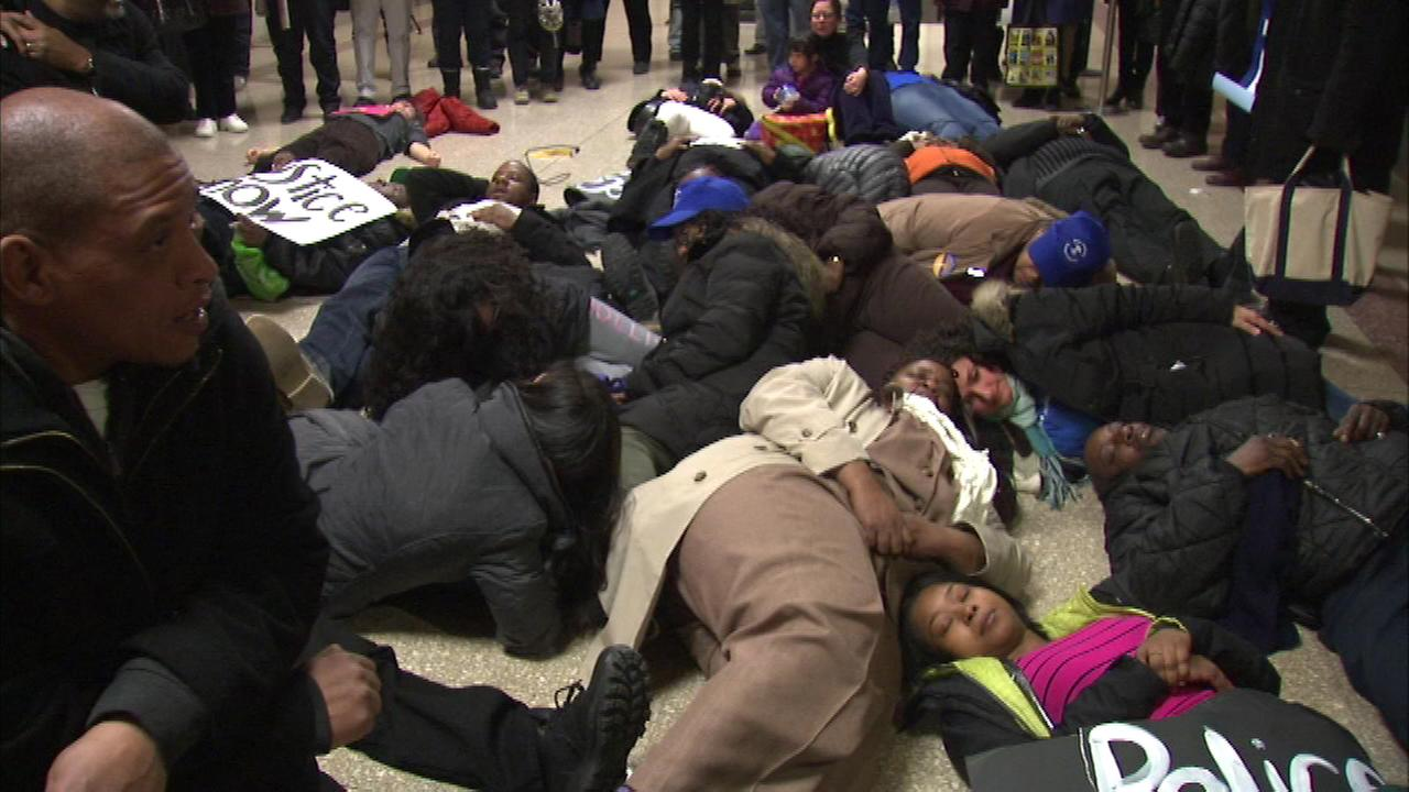 Protesters hold die-in at City Hall