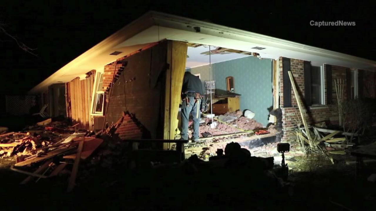Three people were injured after the car they were riding in crashed into a Libertyville home.