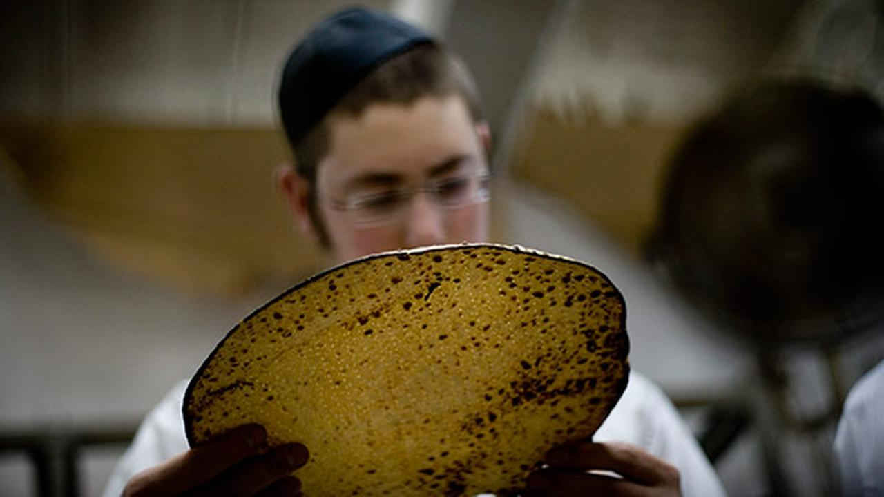 An Ultra-Orthodox Jewish man examines a special Matza, a traditional handmade Passover unleavened bread, in a bakery in Kfar Chabad near Tel Aviv, Israel on April 11, 2011.