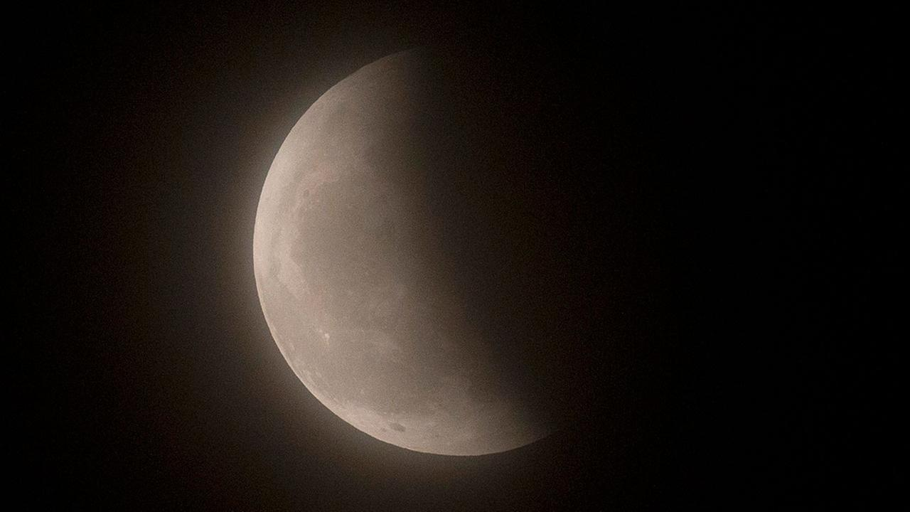 The moon is seen during a lunar eclipse phase, Beijing on April 4, 2015.