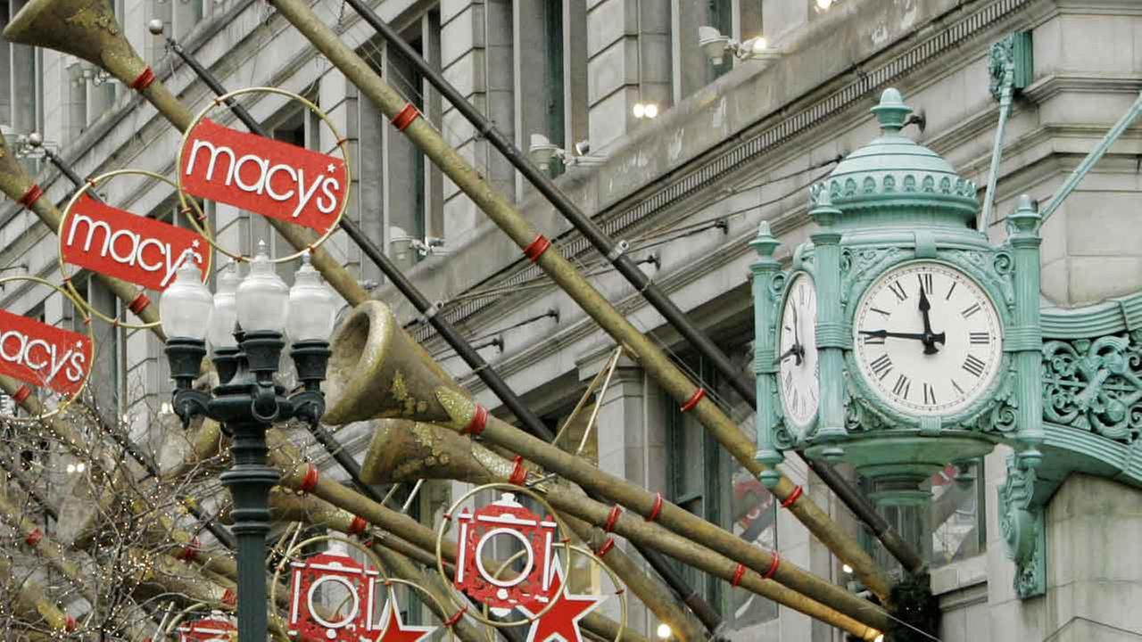 (FILE) The famed Marshall Fields clock anchors the holiday display at Macys State Street store in downtown Chicago, Friday, Nov. 10, 2006.