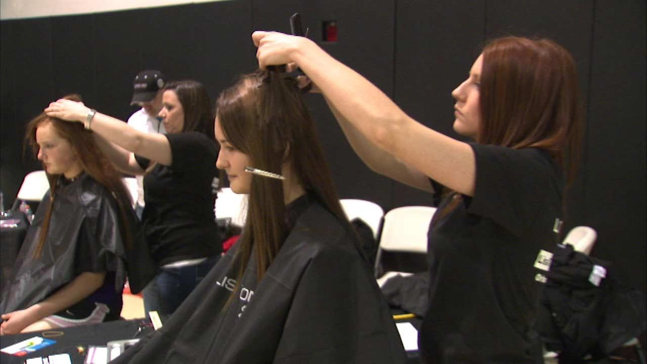 Dozens of west suburban volleyball players cut their hair Sunday to help cancer patients.