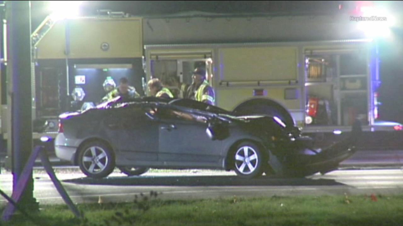 1 dead after crash between car, semi in Elwood