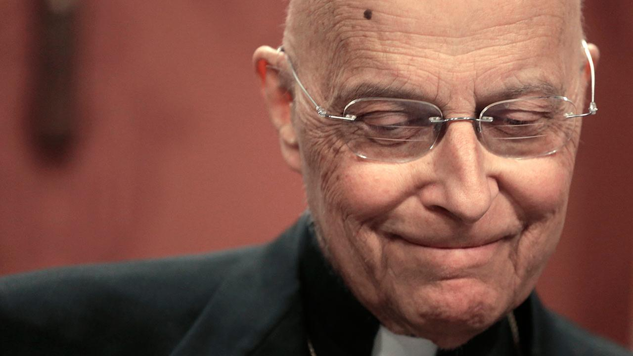 Cardinal Francis George pauses during a news conference in Chicago on April 11, 2013.