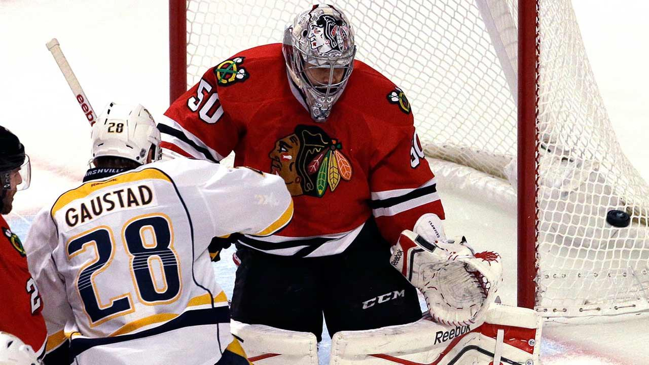 Chicago Blackhawks goalie Corey Crawford, right, blocks a shot by Nashville Predators center Paul Gaustad (28) during the third period in Game 6 Saturday in Chicago.