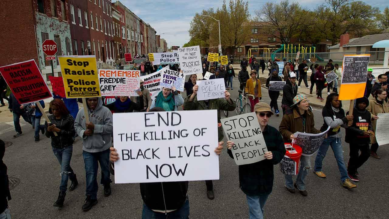 Demonstrators protest in the streets as they march for Freddie Gray to Baltimores City Hall on April 25, 2015.