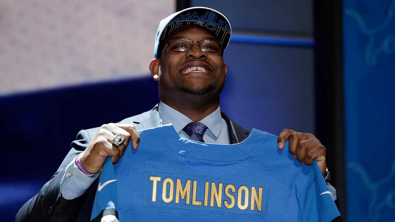 Laken Tomlinson stands on stage after being drafted 28th by the Detroit Lions during the first round of the 2015 NFL Draft, Thursday, April 30, 2015, in Chicago.