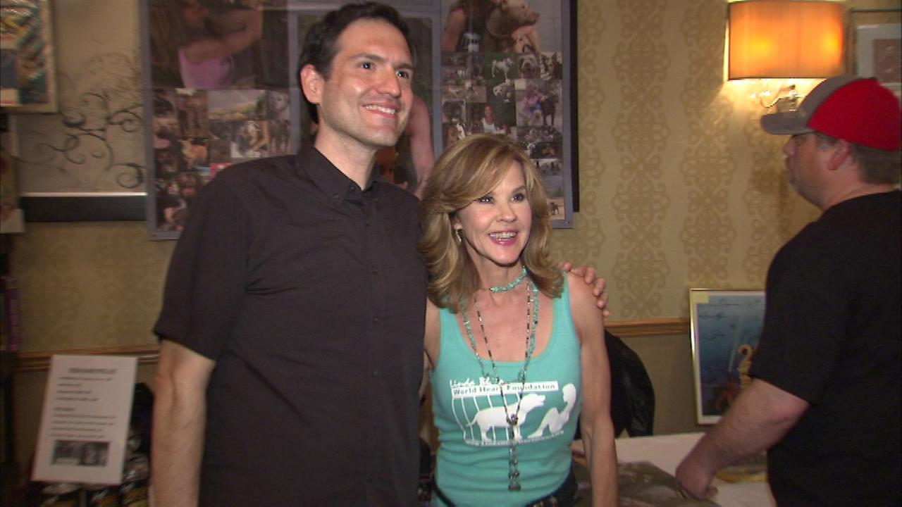 A lucky fan gets a photo taken with The Exorcist star Linda Blair at the Hollywood Show in Rosemont Saturday.