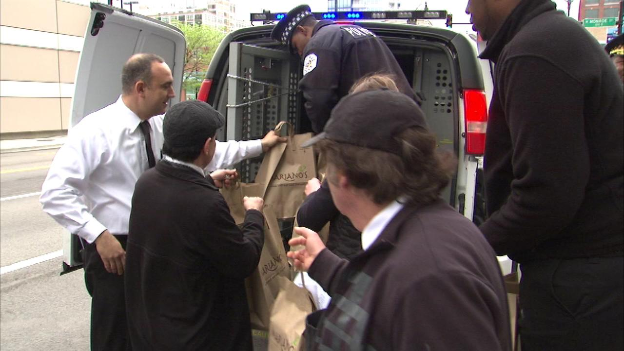 CPD stuffing squad cars with food for those in need