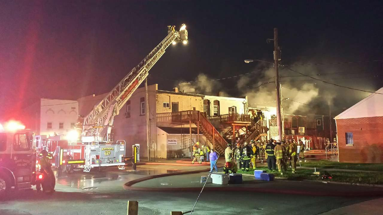 1 hospitalized after large building fire in Utica