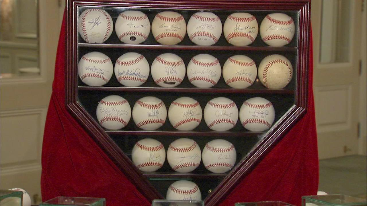 The highlight of the auction is a collection of 26 baseballs each autographed by a Major League player who has hit 500 home runs.