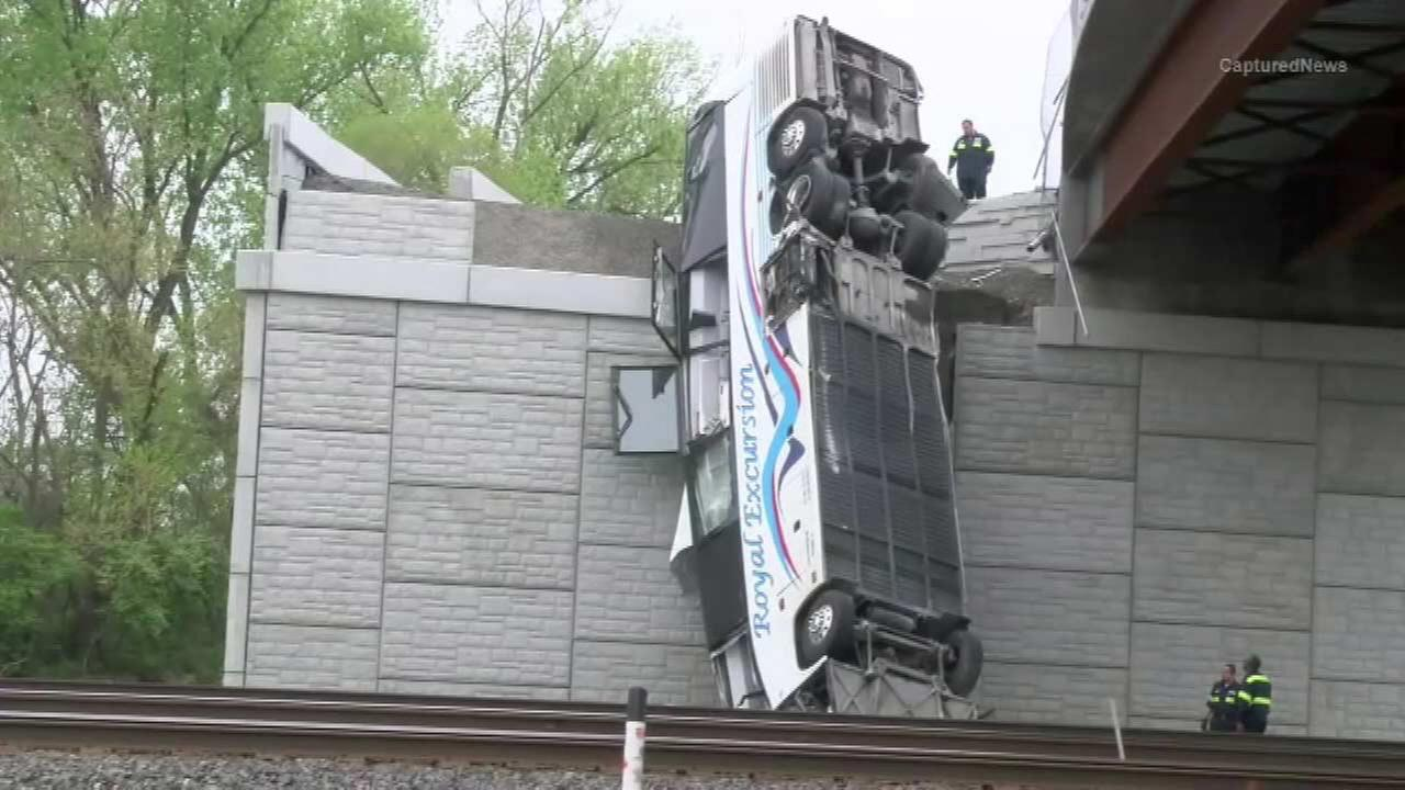 Driver rescued from bus dangling over bridge in Indiana