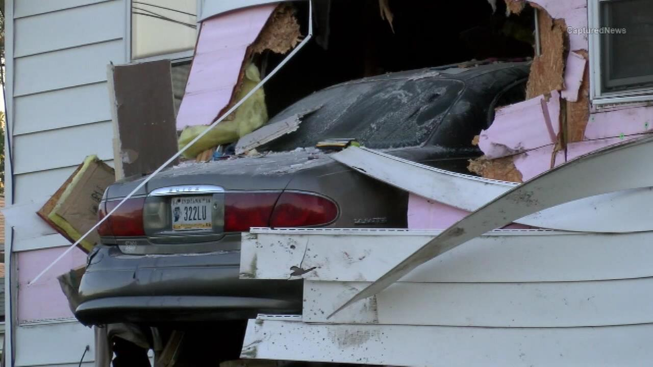 Car crashed into second-story of house