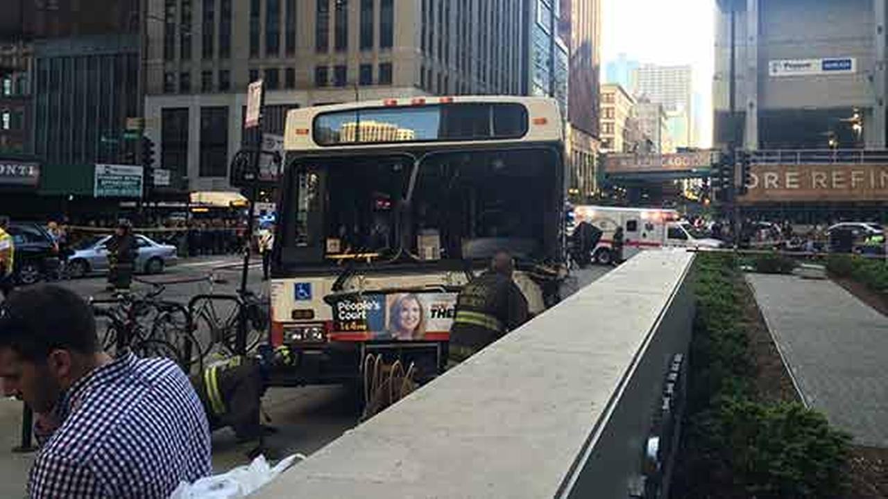 Emergency officials respond to a CTA bus crash on Michigan Avenue near Lake Street.