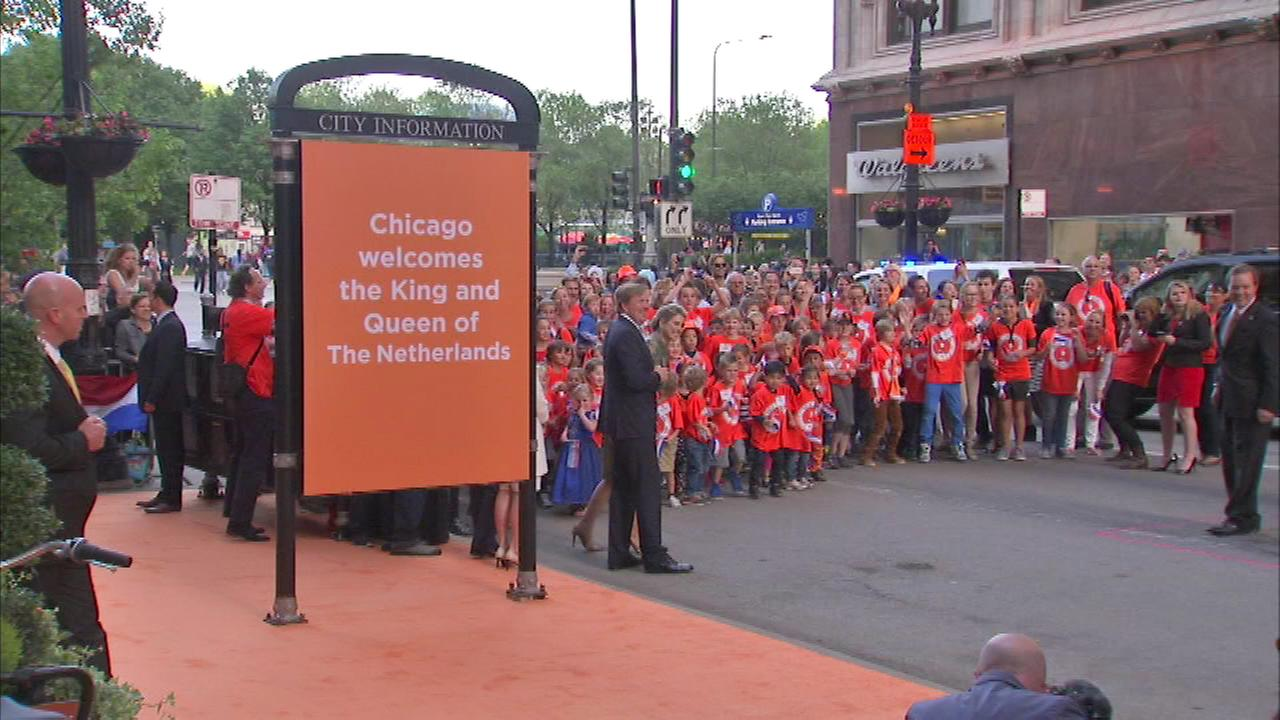 King Willem-Alexander and Queen Maxima were greeted by children outside the Chicago Cultural Center.