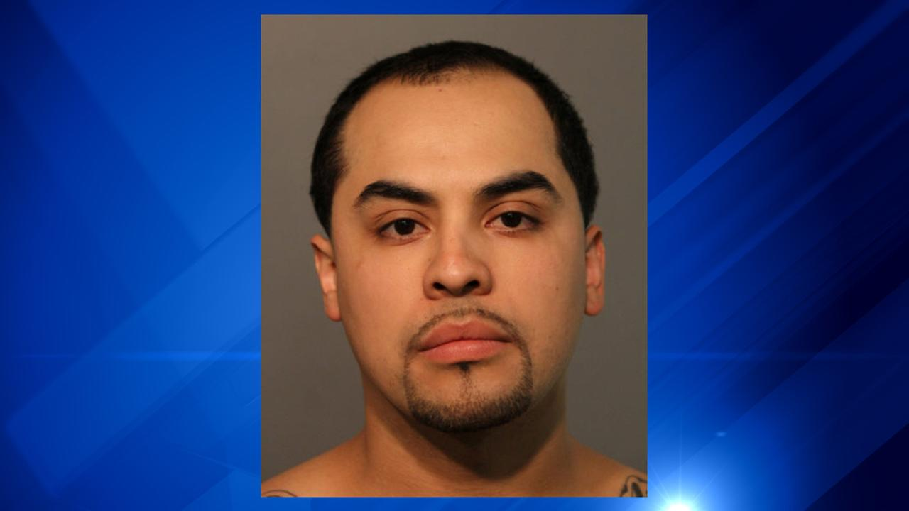 Rafael Corona, 29, was charged after he pointed a gun at a police officer.
