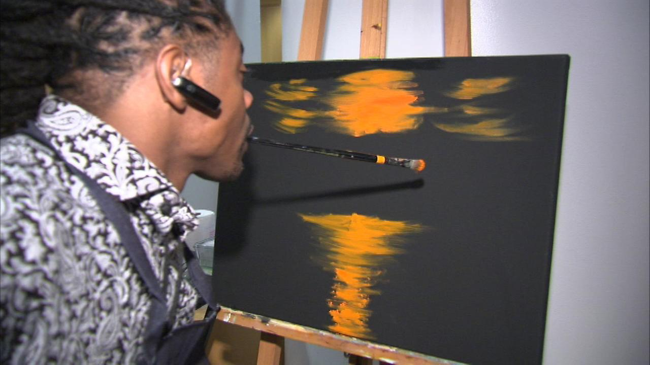 One of the art therapy students paints live at the Art in Motion show at Northwestern Universitys Lurie Center June 22, 2015.