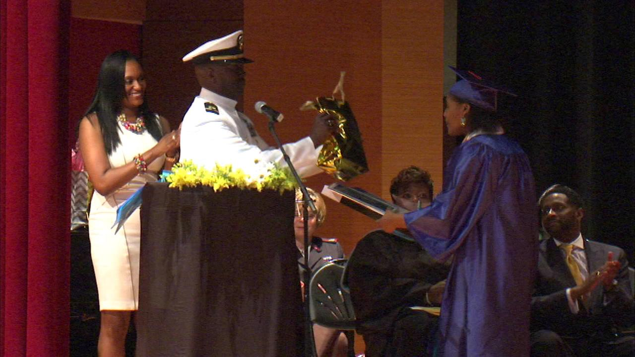Naval officer delivers gifts, scholarships to South Side high school graduates