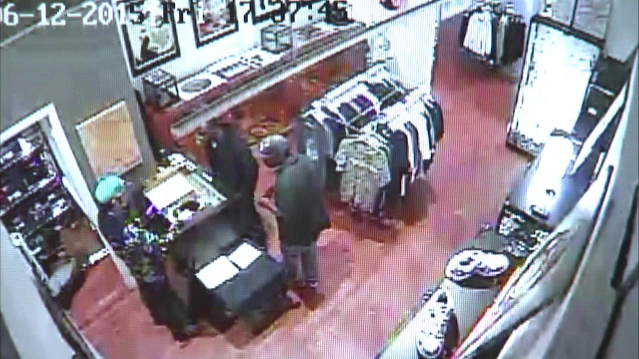 Surveillance video has been released showing two gunmen robbing a store in the Noble Square neighborhood Friday night.