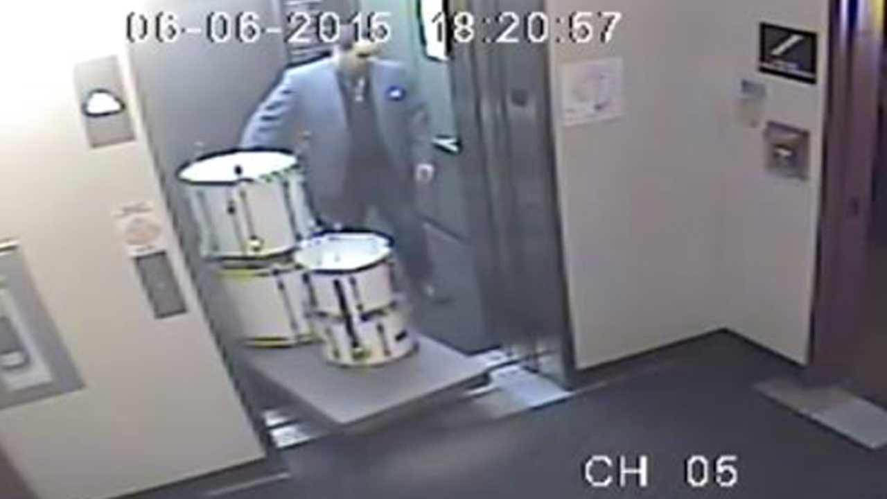 Surveillance footage shows a man stealing a drum set from a Chicago music school.