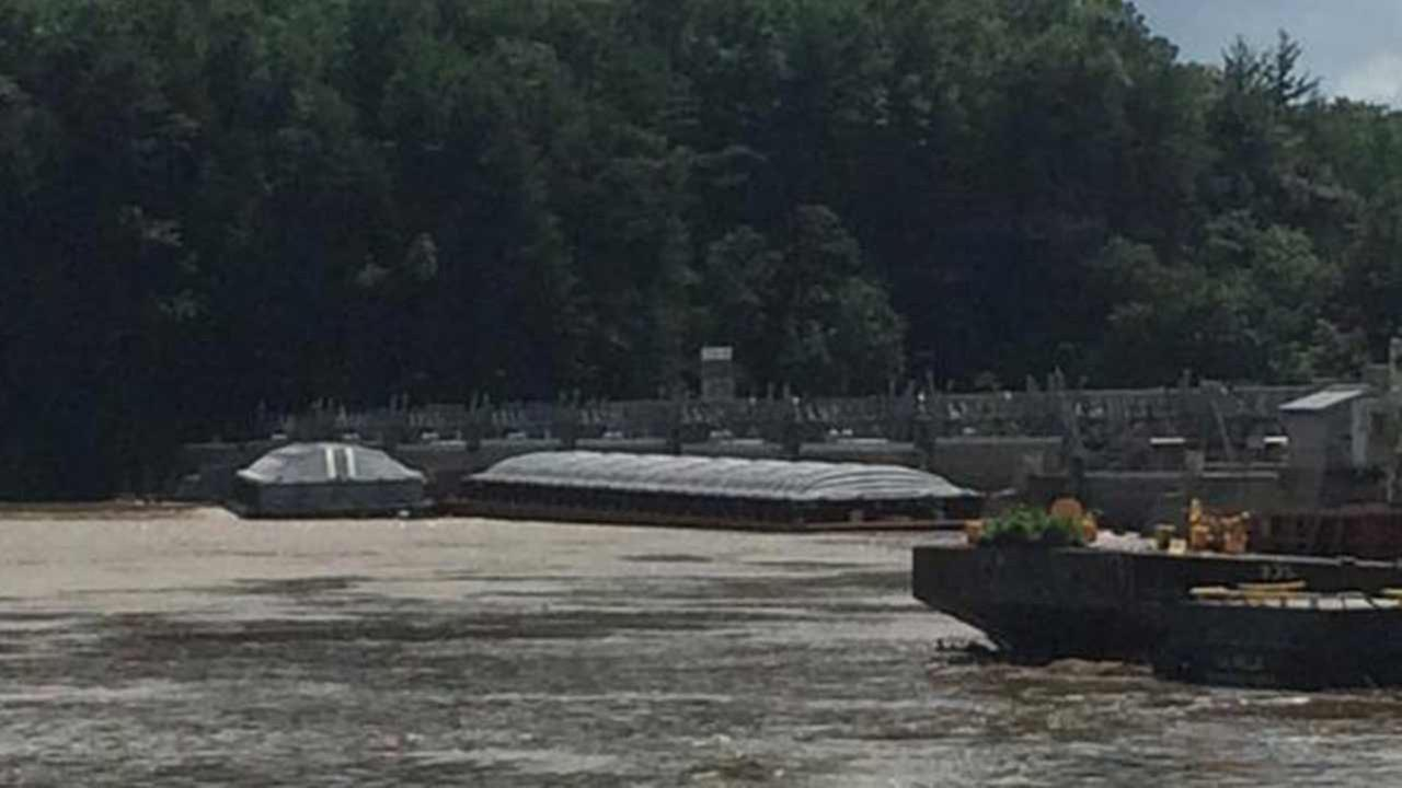 Two large barges have become stuck at the Starved Rock Lock and Dam in North Utica, officials say.