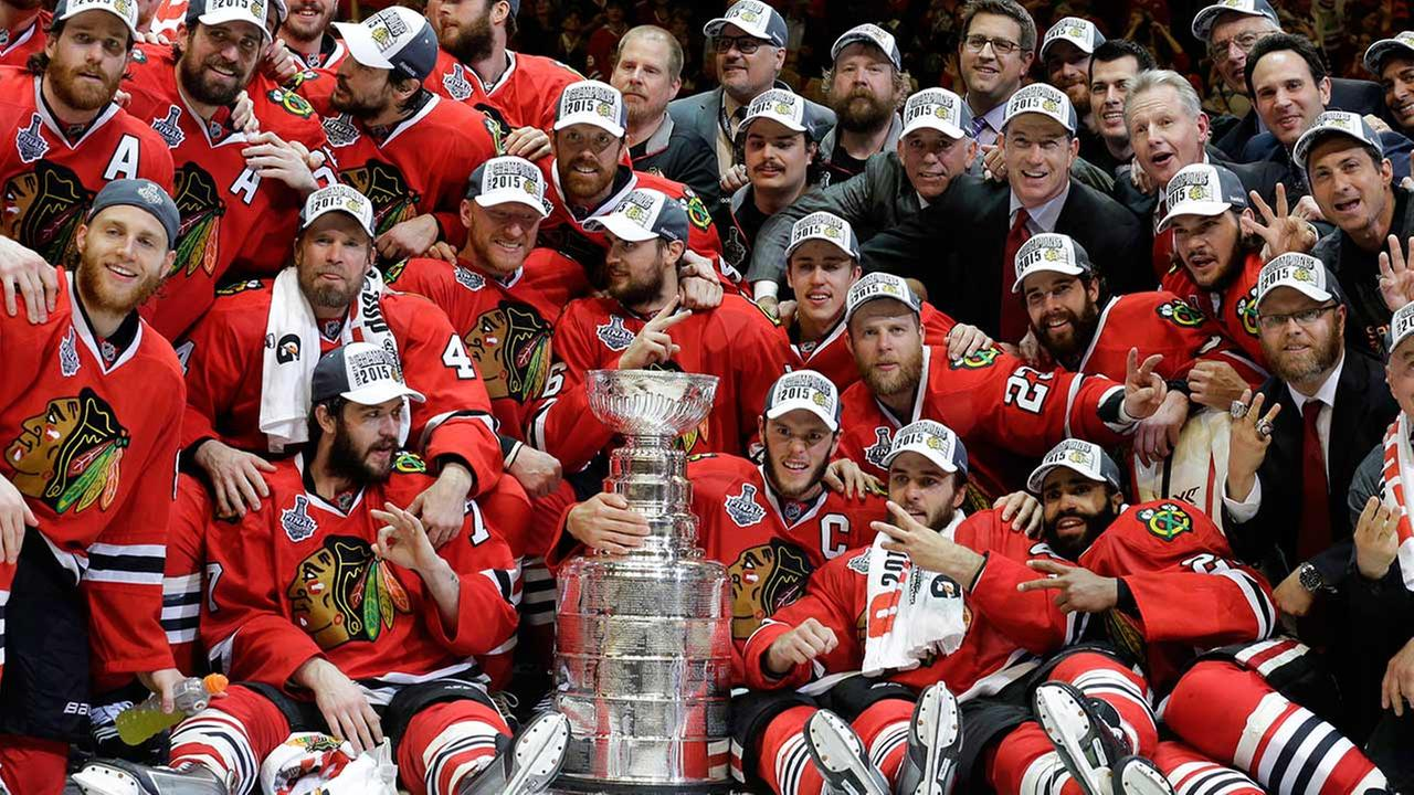 Members of the Chicago Blackhawks pose for pictures as they celebrate after defeating the Tampa Bay Lightning in Game 6 of the NHL hockey Stanley Cup Final.